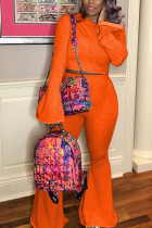 Orange Sexy Solid Split Joint Hooded Collar Long Sleeve Two Pieces