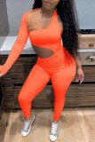 Orange Fashion Sexy Solid Hollowed Out One Shoulder Skinny Jumpsuits