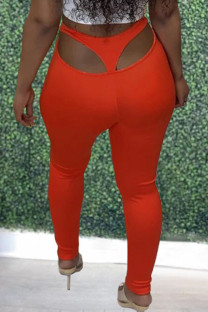 Orange Sexy Casual Solid Hollowed Out Skinny Mid Waist Pencil Trousers
