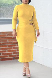 Yellow Fashion Casual Solid Bandage Hollowed Out O Neck Long Sleeve Dresses