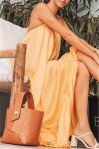 Gold Sexy Casual Solid Backless Spaghetti Strap Loose Sling Dress