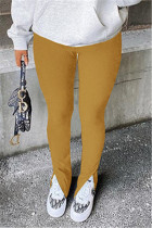 Earth Yellow Fashion Casual Solid Slit Regular Mid Waist Conventional Solid Color Bottoms