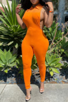 Orange Sexy Casual Solid Hollowed Out Turndown Collar Skinny Jumpsuits
