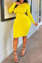 Yellow Fashion Sexy Solid Hollowed Out O Neck Long Sleeve Plus Size Dresses