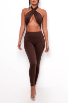 Brown Sexy Casual Solid Hollowed Out Backless Halter Skinny Jumpsuits