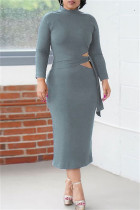 Grey Fashion Casual Solid Bandage Hollowed Out O Neck Long Sleeve Dresses