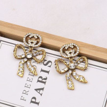 Gold Fashion  Simplicity Letter With Bow Earrings